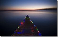 Canoe decorated with Christmas lights on Lake Monona, Madison, Wisconsin, USA