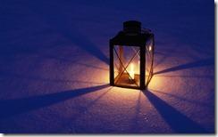 Lantern on snow lit up at night, Sweden
