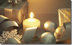 Wrapped gifts, ornaments and candle